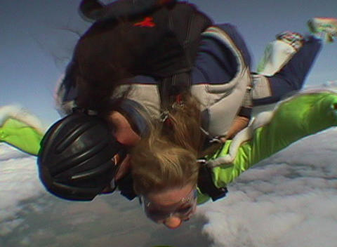 Tandem skydivers barrel roll out of an airplane and free... Stock Video Footage
