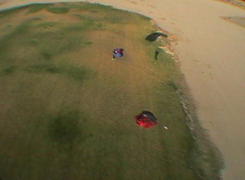 A skydiver lands in a grassy field Stock Video Footage