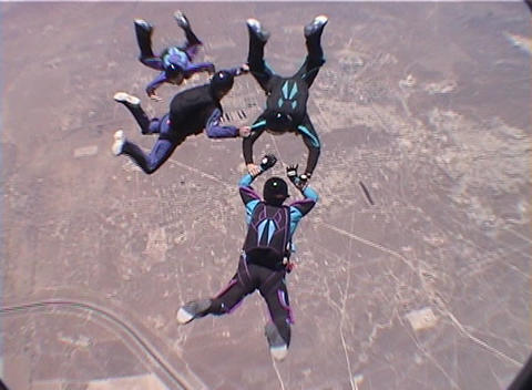 Skydivers leap out of a plane and perform tricks and patterns during free fall Footage