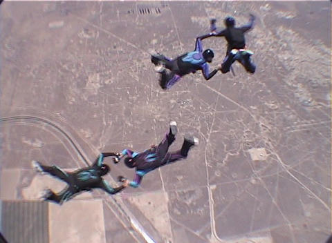 Skydivers leap out of a plane and perform tricks and... Stock Video Footage