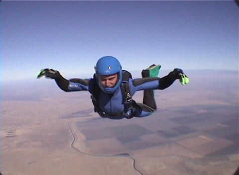A skydiver free-falls and performs maneuvers Live Action