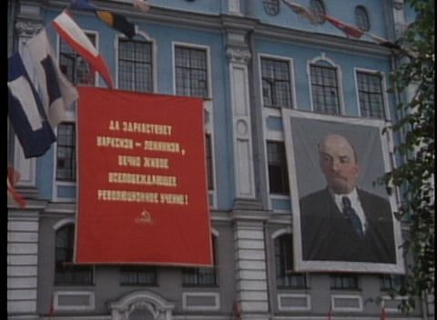 A shot of Lenin is displayed on a building in Moscow in the 1970's Footage