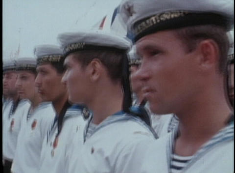 Russian Navy sailors stand along a dock in 1970's USSR Footage