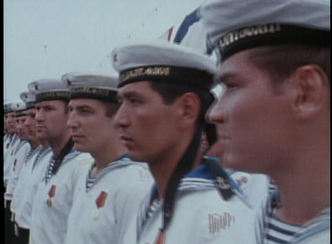 Russian Navy sailors stand along a dock in 1970's USSR Stock Video Footage