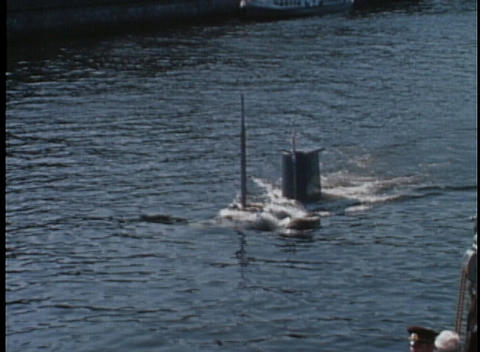 A submarine surfaces in a harbor in 1970's USSR Stock Video Footage