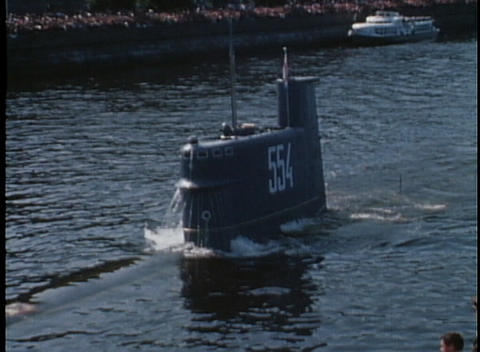 A submarine surfaces in a harbor in 1970's USSR Footage