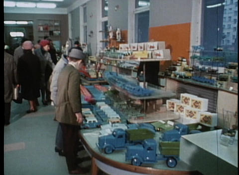 Kids look at toy cars in a retro department store Stock Video Footage