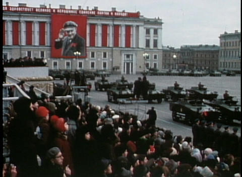 Troops parade with tanks and bombs at an old Soviet military event Footage