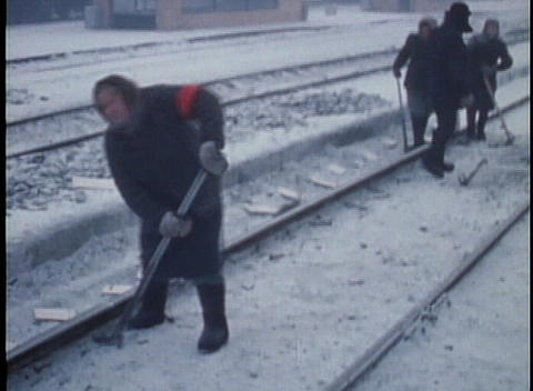 Siberian peasant workers build a railroad in the snow in... Stock Video Footage