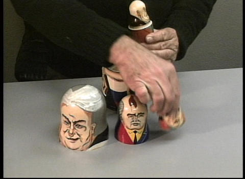 Hands demonstrate Russian nesting dolls with each former... Stock Video Footage