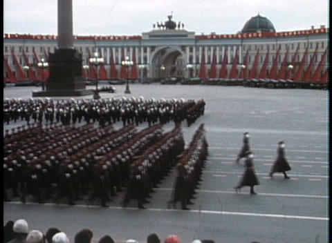 Soviet troops march in a grand parade during the Cold War Stock Video Footage