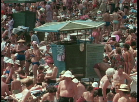Huge crowds amass at the beach on a summer day in the... Stock Video Footage