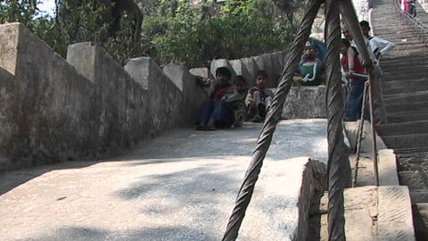 Nepal children playing and smiling while sliding down a... Stock Video Footage