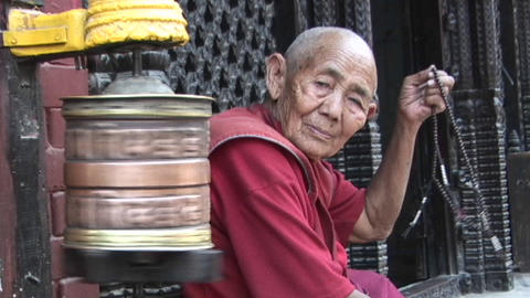 Old Buddhist monk (or nun) with prayer beads next to... Stock Video Footage