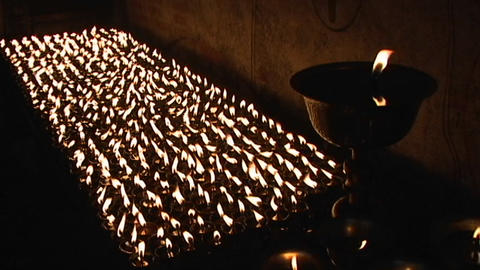 Buddhist candles burning inside a small temple in Kathmandu Stock Video Footage