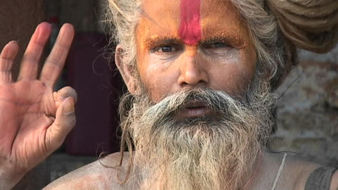 Hindu Sadhu - (Holy man) chanting and posing with religious hand gesture at Pashupati Temple in Kath Footage
