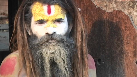 Hindu Sadhu - (Holy man) looking at the camera at... Stock Video Footage