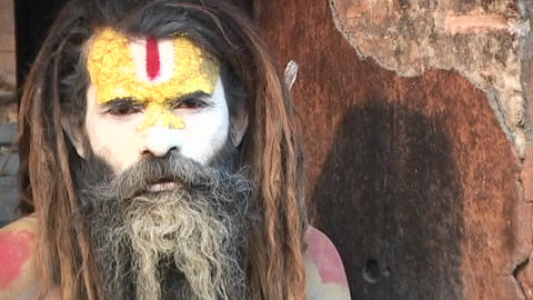 Hindu Sadhu - (Holy man) looking at the camera at Pashupati Temple in Kathmandu Footage