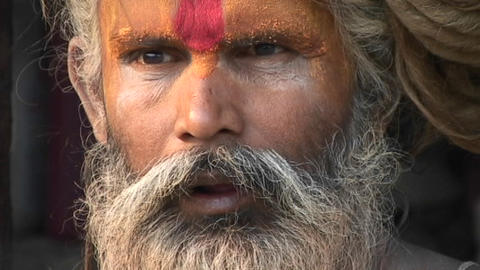 Close up on the face of a Hindu Sadhu - (Holy man)at Pashupati Temple in Kathmandu Footage