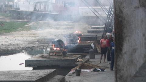 Burning dead bodies at Pashupati Temple in Kathmandu Footage