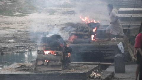 Burning dead bodies at Pashupati Temple in Kathmandu Stock Video Footage