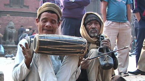 Nepalese musicians playing traditional Nepalese music in front of a crowd in Kathmandu Footage