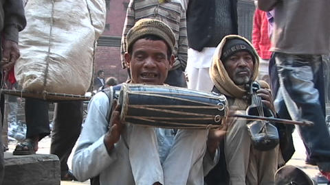 Man and a group watches Nepalese musicians playing... Stock Video Footage
