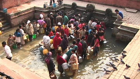 Large group of Nepalese waiting to get drinking water in... Stock Video Footage
