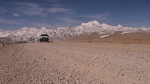 Truck drives on dirt road with beautiful Himalayan... Stock Video Footage