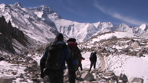 Climbers leaving base camp walking towards the North Face... Stock Video Footage