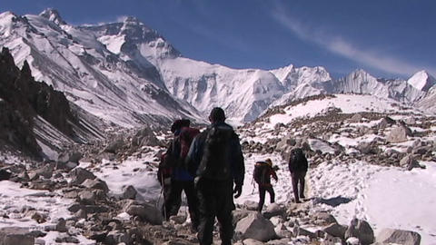 Climbers leaving base camp walking towards the North Face of Mt. Everest Footage