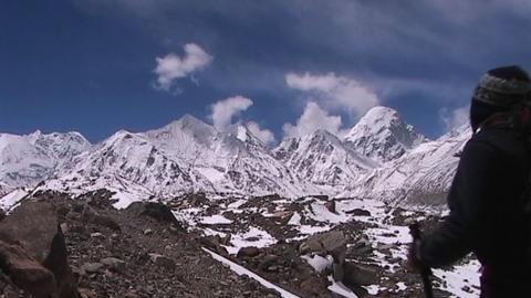 Climber walks into panoramic Himalayan background Stock Video Footage