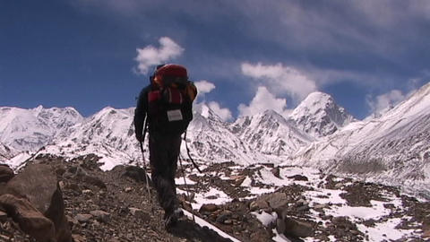 Climber walks into panoramic Himalayan background Footage