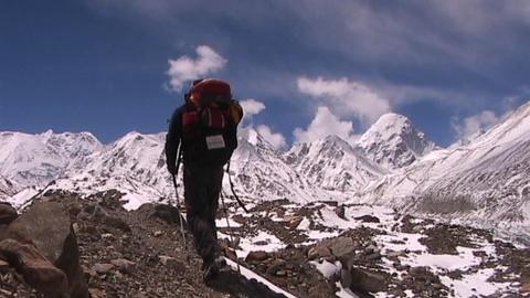 Climber walks into panoramic Himalayan background Footage