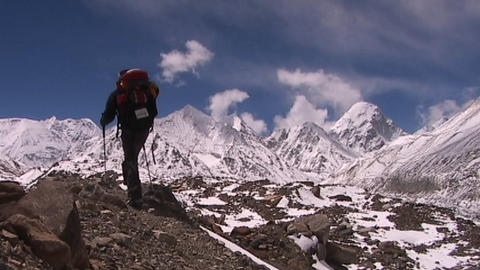 Climber walks into panoramic Himalayan background Stock Video Footage