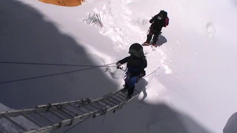 Climber climbs up ladders on Mt. Everest Stock Video Footage