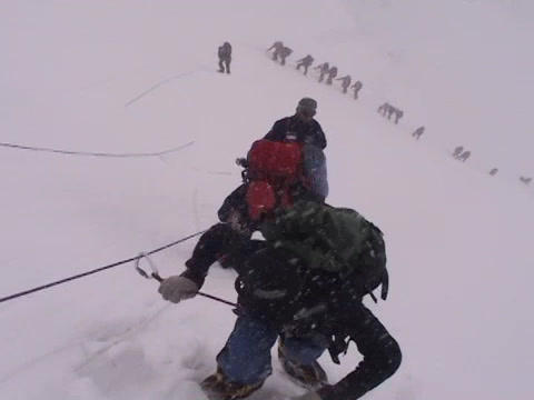 A team of climbers ascends an icy slope on Mt.  Everest Footage