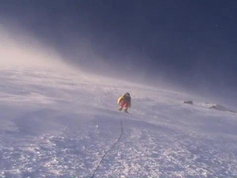Climber ascends vertical slopes of Mt. Everest Stock Video Footage
