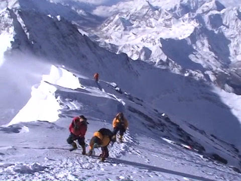 Beautiful summit shot from atop Mt. Everest - climbers just a few steps away Footage