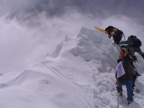 Climbers reaching the top of a Himalayan peak Stock Video Footage