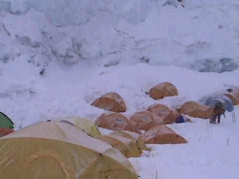 Snow falling on tents high up on Everest Stock Video Footage