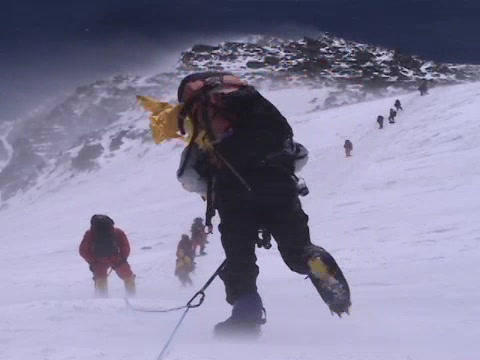 Difficult climbing on Everest - a group of climbers ascend up the mountain Footage