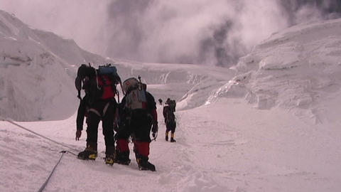 A team of climbers ascends an icy slope on Mt. Everest as... Stock Video Footage