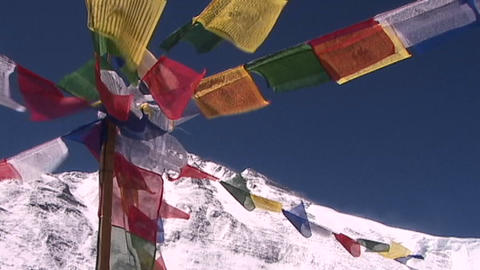 Buddhist prayer flags blowing in the wind as the summit... Stock Video Footage