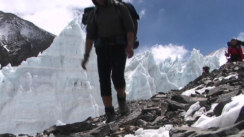 Climbers walk in front of ice pyramids Stock Video Footage