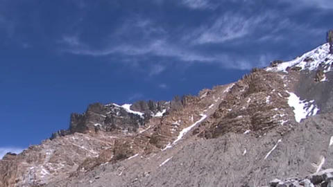 Clouds moving across a summit ridge near Mt. Everest Stock Video Footage