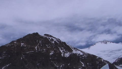Time lapse of clouds moving over two summit peaks near Mt. Everest Footage