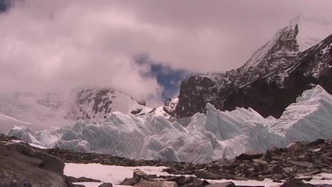 Time lapse of clouds moving across pyramids of ice (ice seracs) Footage