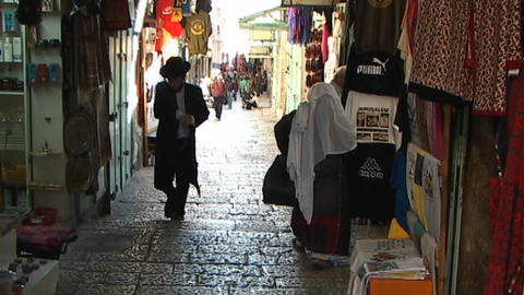 Hasidic man walking the streets of old city Jerusalem near the Great Wall Footage
