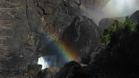 A dramatic panoramic view of a waterfall from the spray... Stock Video Footage